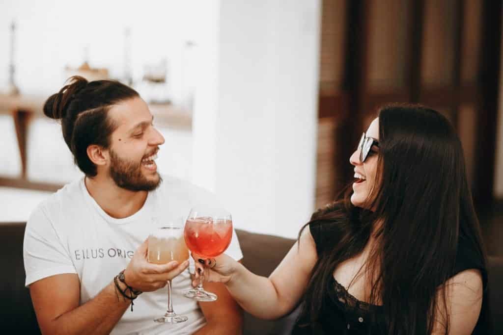 Two people having a nice conversation with a drink
